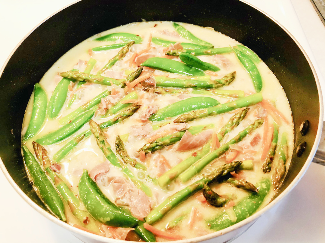 vegetables in a pan with sauce