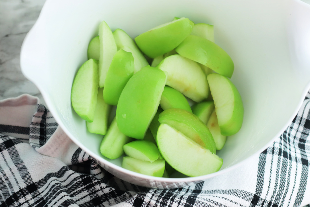 green apple slices in a bowl